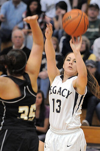 Legacy's Jordan Salaz shoots the ball over Prairie View's Cierra Quinonez during Saturday's state 5A playoff game at Legacy. February 24, 2012  staff photo/ David R. Jennings
