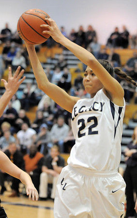 Legacy's Kailey Edwards grabs the ball against Prairie View during Saturday's state 5A playoff game at Legacy.<br /> February 24, 2012 <br /> staff photo/ David R. Jennings