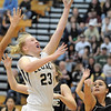 Legacy's Caitlyn Smith goes to the basket against Prairie View's Cierra Quinonez during Saturday's state 5A playoff game at Legacy.<br /> February 24, 2012 <br /> staff photo/ David R. Jennings