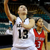 "LegacyVsRegis005.JPG Legacy High School senior Taylor Archuleta drives to the basket on Friday, March 4, in a game against Regis Jesuit High School during the Colorado High School ""Great 8"" tournament at the Denver Coliseum. Legacy lost the game 59-67. For more photos go to  <a href=""http://www.dailycamera.com"">http://www.dailycamera.com</a><br /> Jeremy Papasso/ Camera"