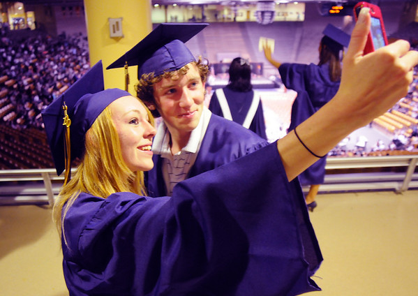 Sarah Leister, left, and Blake Davis take a picture of themselves before Wednesday's 10th Legacy HIgh School graduation at Coors Events Center at CU.<br /> May 19, 2010<br /> Staff photo/ David R. Jennings
