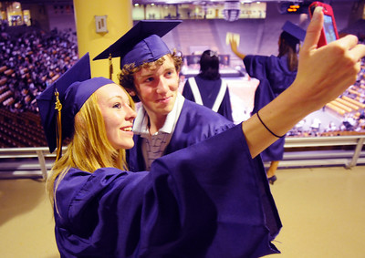Sarah Leister, left, and Blake Davis take a picture of themselves before Wednesday's 10th Legacy HIgh School graduation at Coors Events Center at CU. May 19, 2010 Staff photo/ David R. Jennings