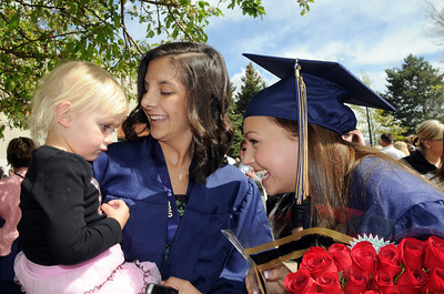 Kaylyn Little, center and Ashleigh Hansen talk to Little's cousin Marleigh Little, 3, after Wednesday's 10th Legacy HIgh School graduation at Coors Events Center at CU. May 19, 2010 Staff photo/ David R. Jennings