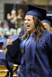 Elizabeth Korodaj cheers after receiving her diploma during Wednesday's 10th Legacy HIgh School graduation at Coors Events Center at CU. May 19, 2010 Staff photo/ David R. Jennings