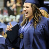 Elizabeth Korodaj cheers after receiving her diploma during Wednesday's 10th Legacy HIgh School graduation at Coors Events Center at CU.<br /> May 19, 2010<br /> Staff photo/ David R. Jennings