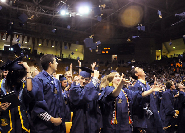 Graduates toss their hats in the air during Wednesday's 10th Legacy HIgh School graduation at Coors Events Center at CU.<br /> May 19, 2010<br /> Staff photo/ David R. Jennings