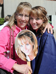 Karen Eisenmenger, left, holds both a photo of her  daughter Jordyn, right, and a photo of  Jordyn after Wednesday's 10th Legacy HIgh School graduation at Coors Events Center at CU. May 19, 2010 Staff photo/ David R. Jennings
