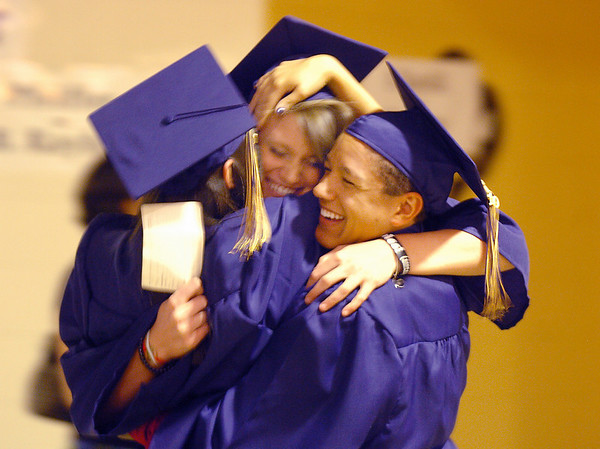 Kelsey Padilla, left, Carli Moreland and Eric Phillips hug each other before  Wednesday's 10th Legacy HIgh School graduation at Coors Events Center at CU.<br /> May 19, 2010<br /> Staff photo/ David R. Jennings