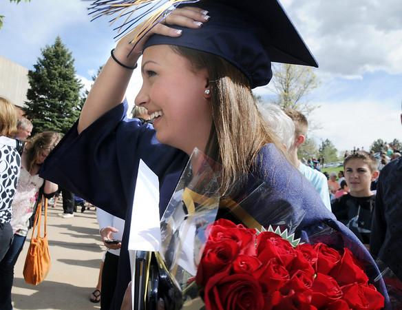 Ashleigh Hansen looks for friends after Wednesday's 10th Legacy HIgh School graduation at Coors Events Center at CU.<br /> May 19, 2010<br /> Staff photo/ David R. Jennings