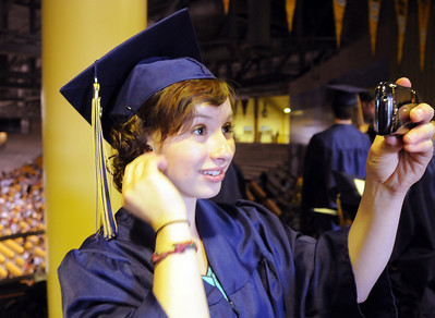 Rose-Anna Martin uses her phone to check her hair before Wednesday's 10th Legacy HIgh School graduation at Coors Events Center at CU. May 19, 2010 Staff photo/ David R. Jennings