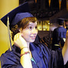Rose-Anna Martin uses her phone to check her hair before Wednesday's 10th Legacy HIgh School graduation at Coors Events Center at CU.<br /> May 19, 2010<br /> Staff photo/ David R. Jennings