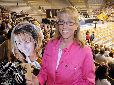 Karen Eisenmenger holds a picture of her daughter Jordyn before Wednesday's 10th Legacy HIgh School graduation at Coors Events Center at CU. May 19, 2010 Staff photo/ David R. Jennings
