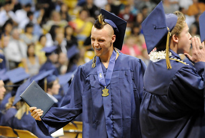 Clinton Sindelar celebrates after receiving his diploma during Wednesday's 10th Legacy HIgh School graduation at Coors Events Center at CU. May 19, 2010 Staff photo/ David R. Jennings