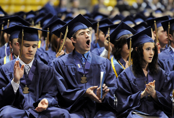 Austin Linton, center, gives a cheer with fellow graduates Luke Linscheid, left, and Anna Lister during Wednesday's 10th Legacy HIgh School graduation at Coors Events Center at CU.<br /> May 19, 2010<br /> Staff photo/ David R. Jennings