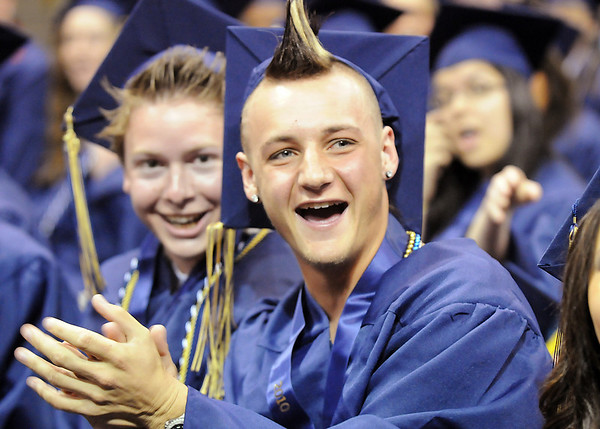 Clinton Sindelar gives a cheer during Wednesday's 10th Legacy HIgh School graduation at Coors Events Center at CU.<br /> May 19, 2010<br /> Staff photo/ David R. Jennings