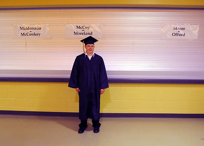John Miller waits for fellow graduates to line up before Wednesday's 10th Legacy HIgh School graduation at Coors Events Center at CU. May 19, 2010 Staff photo/ David R. Jennings
