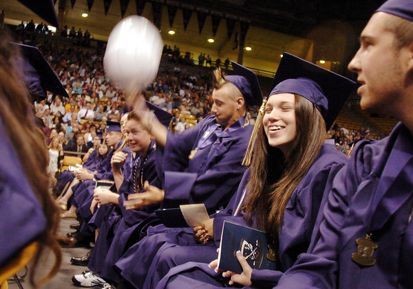 Clinton Sindelar , center, tosses a beach ball back to fellow graduates during Wednesday's 10th Legacy HIgh School graduation at Coors Events Center at CU.<br /> May 19, 2010<br /> Staff photo/ David R. Jennings