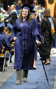 Elizabeth Korodaj walks back to her chair after receiving her diploma during Wednesday's 10th Legacy HIgh School graduation at Coors Events Center at CU. May 19, 2010 Staff photo/ David R. Jennings