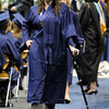 Elizabeth Korodaj walks back to her chair after receiving her diploma during Wednesday's 10th Legacy HIgh School graduation at Coors Events Center at CU.<br /> May 19, 2010<br /> Staff photo/ David R. Jennings