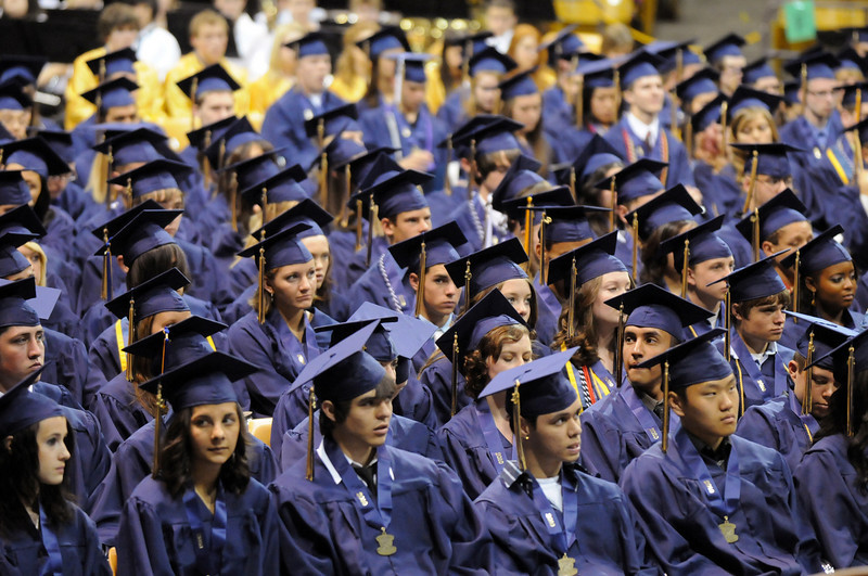 The graduates listen to speeches during Wednesday's 10th Legacy HIgh School graduation at Coors Events Center at CU.<br /> May 19, 2010<br /> Staff photo/ David R. Jennings