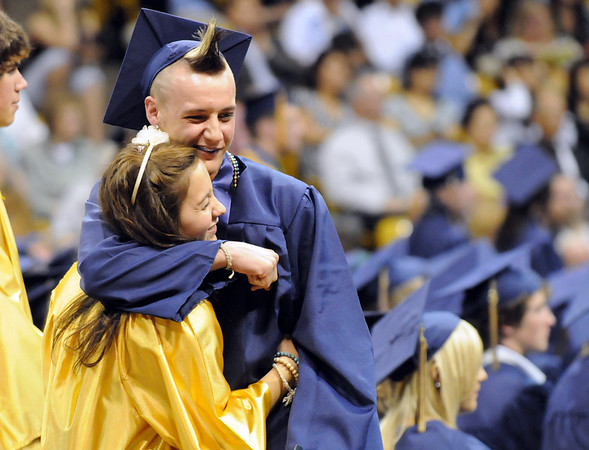 Clinton Sindelar hugs one of the junior escorts after receiving his diploma during Wednesday's 10th Legacy HIgh School graduation at Coors Events Center at CU.<br /> May 19, 2010<br /> Staff photo/ David R. Jennings