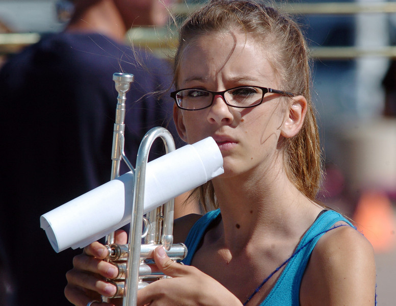 Morgan Benavidez listens to instructions while holding her trumpet during Legacy High School bands practice on Saturday at the school.<br /> <br /> September 25, 2010<br /> staff photo/David R. Jennings