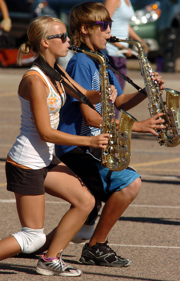 Legacy High School band saxophone players Paige Becker, left, and Kory Clark march and play their instruments while marching during Saturday's practice at the school.<br /> <br /> September 25, 2010<br /> staff photo/David R. Jennings