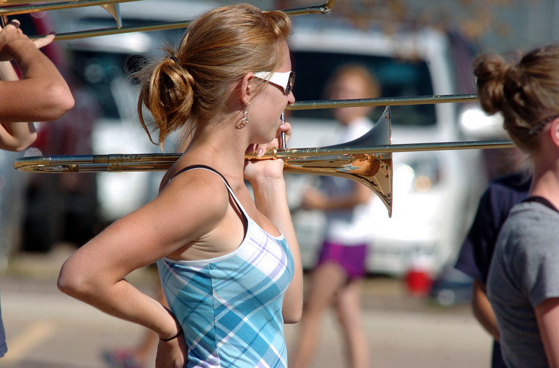 Legacy High School band member Kelsy Clark listens to instructions while holding her trombone during Saturday practice at the school.<br /> <br /> September 25, 2010<br /> staff photo/David R. Jennings