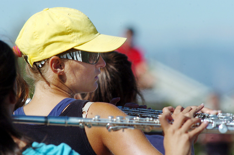 Hannah Wold, Legacy High School band member, prepares to play her flute while marching during Saturday's practice at the school.<br /> <br /> September 25, 2010<br /> staff photo/David R. Jennings