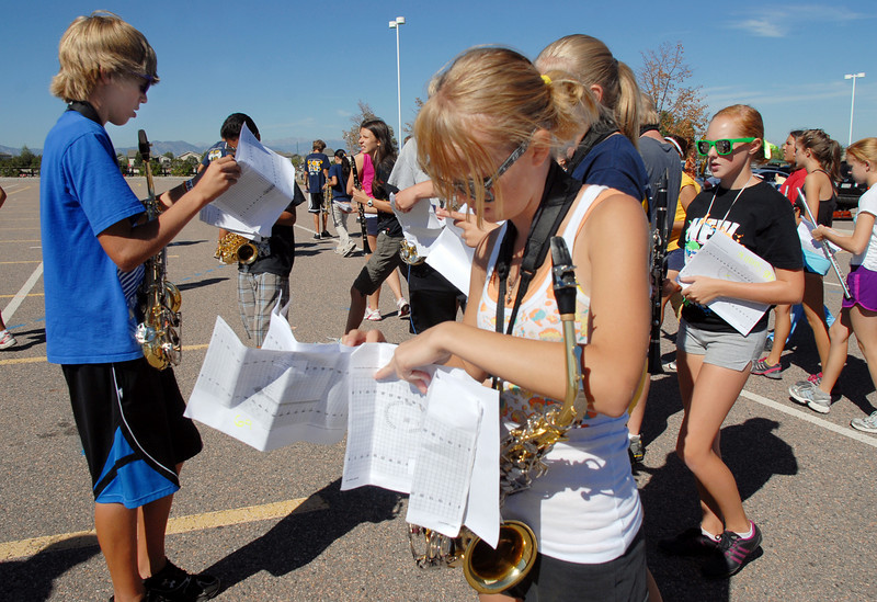 Kory Clark, left, and Paige Becker saxophone players for the Legacy High School band check their marching sheets during Saturday's practice at the school.<br /> <br /> September 25, 2010<br /> staff photo/David R. Jennings