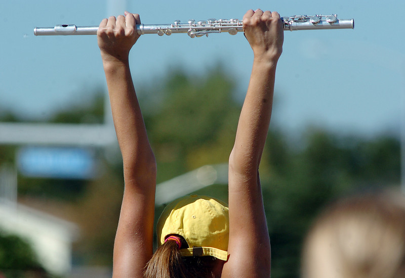 Legacy High School band member Hannah Wold raises her flute to strike a pose during Saturday's practice at the school.<br /> <br /> September 25, 2010<br /> staff photo/David R. Jennings
