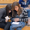 Miranda Ireland, left, and Anna Wanek compare their schedules while waiting in the gym during freshman orientation day at Legacy High School on Wednesday. <br /> <br /> August 19, 2009<br /> staff photo/David R. Jennings