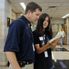 Assistant Principal Lee Peters, left, looks at  Michael Baird's schedule during freshman orientation day at Legacy High School on Wednesday. <br /> <br /> August 19, 2009<br /> staff photo/David R. Jennings
