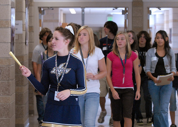 Cheerleader Chelsea Beamer, center, leads a group of freshman on a tour of the school during freshman orientation day at Legacy High School on Wednesday. <br /> <br /> <br /> August 19, 2009<br /> staff photo/David R. Jennings