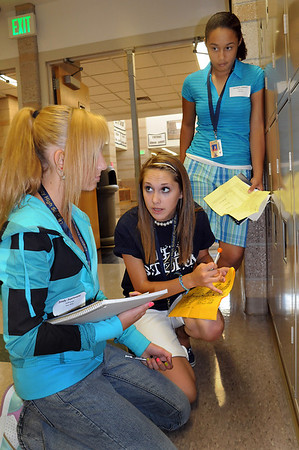 Junior Elise Curtis, center, helps Sindy Santovena, left, and Jocilynn Howard with directions to classrooms during freshman orientation day at Legacy High School on Wednesday. <br /> <br /> August 19, 2009<br /> staff photo/David R. Jennings