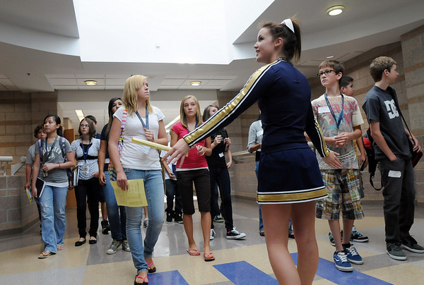 Cheerleader Chelsea Beamer, center, leads a group of freshman on a tour of the school during freshman orientation day at Legacy High School on Wednesday. <br /> <br /> August 19, 2009<br /> staff photo/David R. Jennings