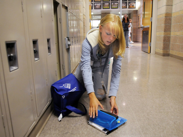 Paige Becker organizes her locker during freshman orientation day at Legacy High School on Wednesday. <br /> <br /> August 19, 2009<br /> staff photo/David R. Jennings