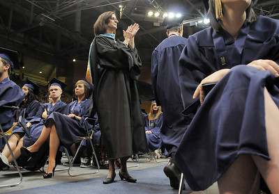 Legacy's principal Cathy Nolan applauds seniors receiving their diplomas during the graduation ceremony on Monday at Coors Event Center in Boulder. May 16, 2011 staff photo/David R. Jennings