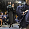 Legacy's principal Cathy Nolan applauds seniors receiving their diplomas during the graduation ceremony on Monday at Coors Event Center in Boulder.<br /> May 16, 2011<br /> staff photo/David R. Jennings