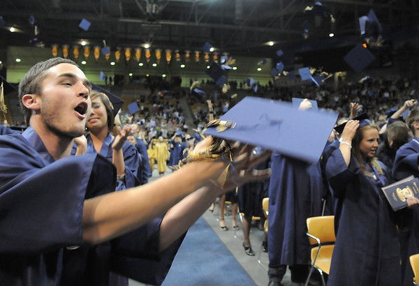 Zacharia Lowry catches his cap after tossing it in the air during Legacy's graduation ceremony on Monday at Coors Event Center in Boulder.<br /> May 16, 2011<br /> staff photo/David R. Jennings