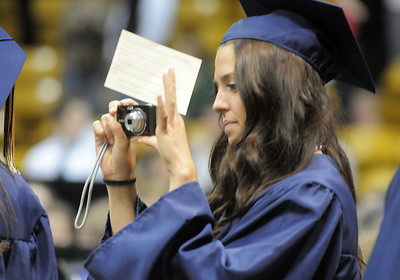 A Legacy senior takes pictures while walking during the processional at graduation on Monday at Coors Event Center in Boulder. May 16, 2011 staff photo/David R. Jennings