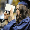 A Legacy senior takes pictures while walking during the processional at graduation on Monday at Coors Event Center in Boulder.<br /> May 16, 2011<br /> staff photo/David R. Jennings