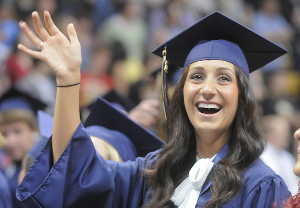 Carissa Loper waves at her family during Legacy's graduation ceremony on Monday at Coors Event Center in Boulder.<br /> May 16, 2011<br /> staff photo/David R. Jennings