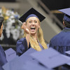 Jordan Neill waves at friends and relatives during the presentation of the diplomas at Legacy's graduation on Monday at Coors Event Center in Boulder.<br /> May 16, 2011<br /> staff photo/David R. Jennings