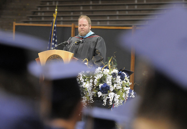 Teacher Michael Osborn gives the faculty speech to the Class of 2011 during Legacy's graduation ceremony on Monday at Coors Event Center in Boulder.<br /> May 16, 2011<br /> staff photo/David R. Jennings
