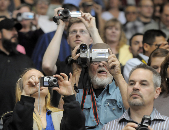 Audience members take pictures of Legacy seniors during the  graduation ceremony on Monday at Coors Event Center in Boulder.<br /> May 16, 2011<br /> staff photo/David R. Jennings