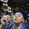 Paul Nguyen blows bubbles during the presentation of the diplomas at Legacy's graduation on Monday at Coors Event Center in Boulder.<br /> May 16, 2011<br /> staff photo/David R. Jennings