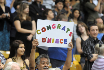 The family of D'Neice Martinez holds up a sign for her during Legacy's graduation on Monday at Coors Event Center in Boulder. May 16, 2011 staff photo/David R. Jennings