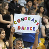 The family of D'Neice Martinez holds up a sign for her during Legacy's graduation on Monday at Coors Event Center in Boulder.<br /> May 16, 2011<br /> staff photo/David R. Jennings