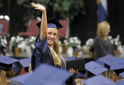 Jordan Neill waves at her family and friends after receiving her diploma during Legacy's graduation on Monday at Coors Event Center in Boulder. May 16, 2011 staff photo/David R. Jennings